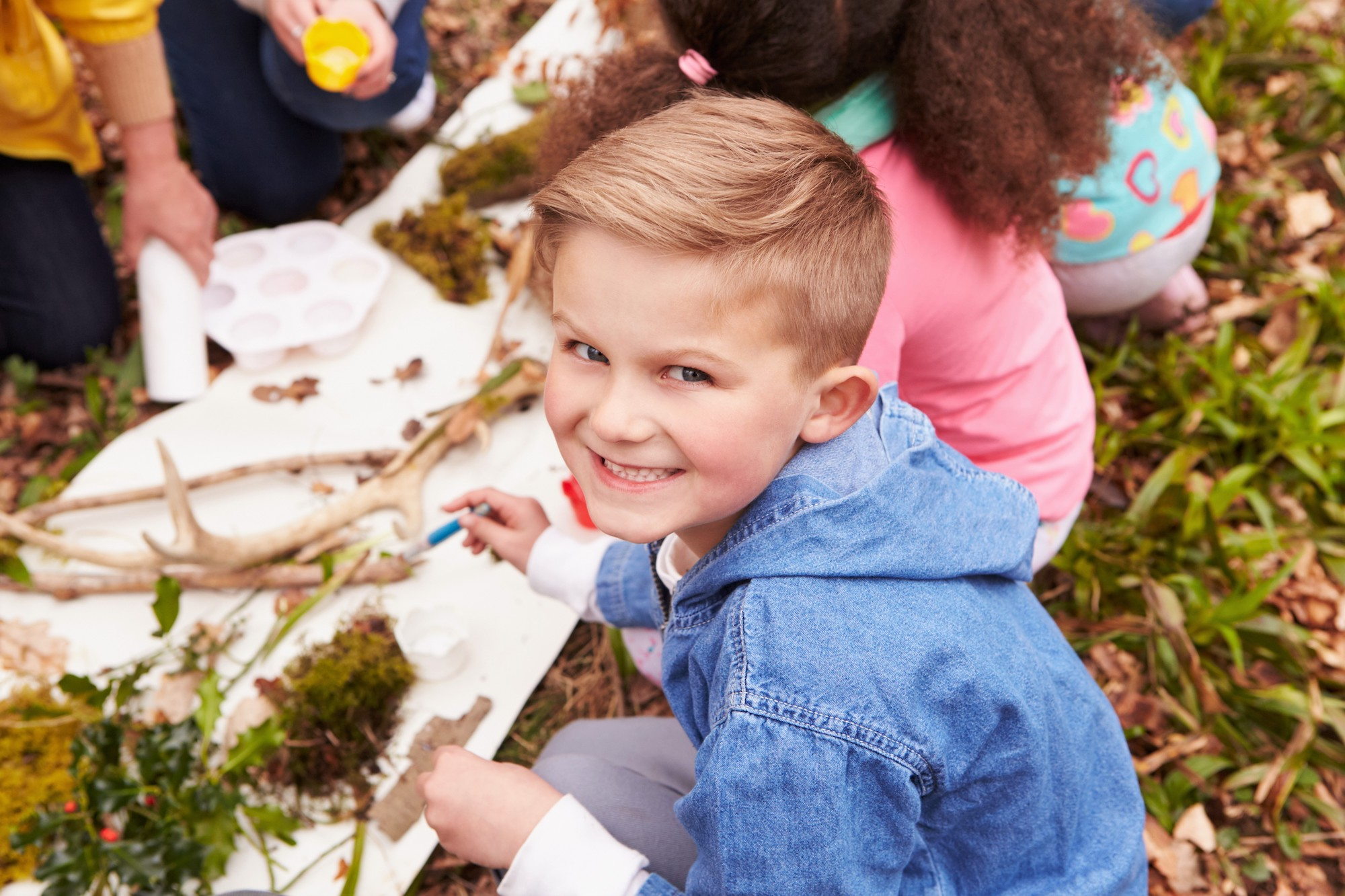 Children work creatively engaging head, heart and hands