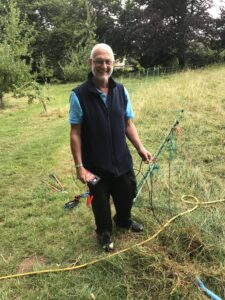 Bill fixing the fencing round the chilckens