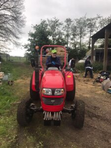 Volunteer driving tractor