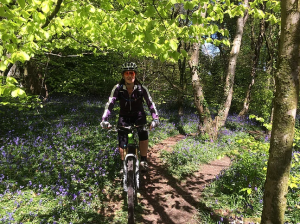 Lady on a bike in the woods